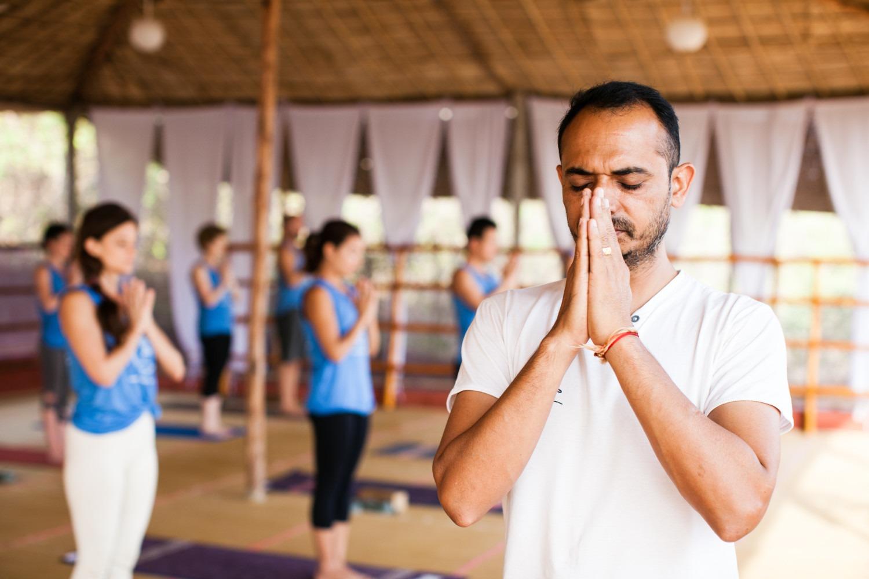 Yoga Teacher with hands in prayer