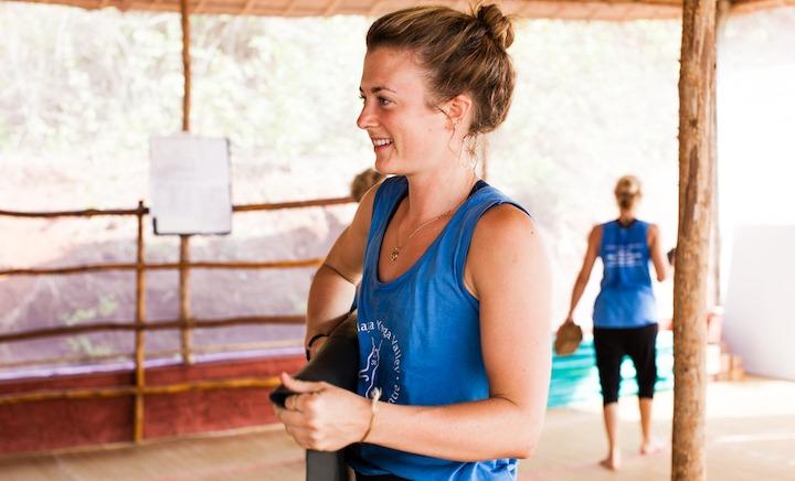 500 Hour Yoga Teacher Training Student with Mat