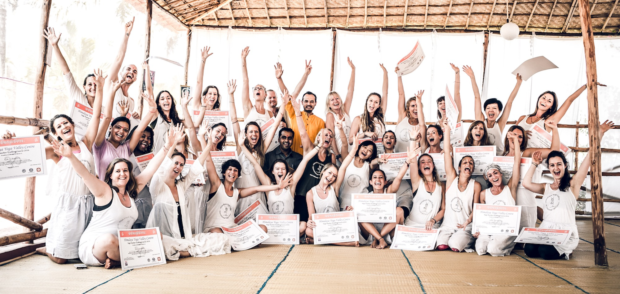 Happy yoga teacher graduates