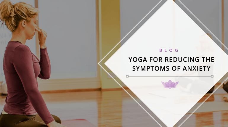 Yoga Teacher teaching breathing exercise to class